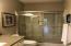 Bathroom adjacent to the kitchen area.