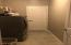 Huge Laundry Room with Storage adjacent to garage.
