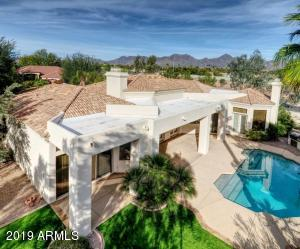 Unobstructed Mountain Views from elevated lot on nearly half acre on outskirts of McCormick Ranch