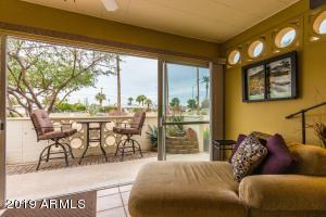 The enclosed lanai/Arizona room leads to a lovely patio