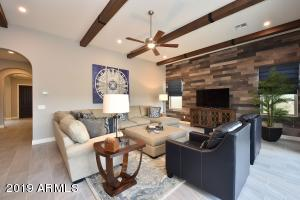 Great Room with Wood Beams & Accent Wall is adjacent the large kitchen