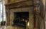 carved wood & granite mantle