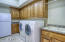 Oversized laundry room with room for extra refrigerator.