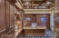 Large library with beautiful built in cabinetry.