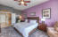 Master bedroom with newer carpeting and ceiling fan!