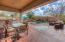 Multiple seating areas in this remodeled backyard! Covered patio 43 feet long that extends the entire length of back of home!