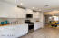 Custom staggered cabinets, quartz countertops and subway tile backsplash and stainless appliances