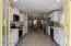 French doors off kitchen open to the back patio and yard-great for entertaining