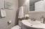 Master Bath with fog free mirror/ medicine cabinet, designer hardware and water-saver toilet