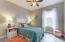 The middle bedroom has tile floor, fan and light, panel closet doors