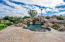 Pebble tec pool with multiple waterfalls, boulders, private spa