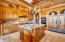 Kitchen view of detailed cabinetry, side by side SubZero fridge/freezer, and center island.