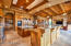 Kitchen view of large L-shaped island and family room