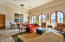Tall great room with bright arched doors