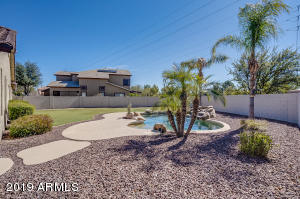 Mature palm trees adds & nicely manicured yard