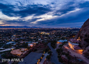 New Price!! Welcome to the Exquisite 4926 E Red Rock Drive. Located on arguably one of the most desirable streets in Arizona (the highest street on the south side of Camelback Mountain), this property boasts ~1.35 Acres of some of the most jaw dropping views imaginable. This rare and unique property/lot is built right up to the top of Camelback Mountain. Featuring both a massive garage and wine cellar built directly into the mountain. This is something you must see to believe. A one of a kind feature that cannot be found anywhere else! The views are absolutely to die for, watch as the entire city lights up at night. Possibilities are endless. Turn this property into the home of your dreams today!
