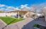 """Professionally landscaped yard with lighting, lawn, and 20'10"""" x 15'6"""" covered patio."""