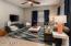 "Living room measures 13'11"" x 13'9""."
