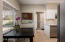 Kitchen with breakfast nook faces east. Laundry room is separated by a lockable door.