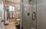Bath 2 offers glass shower enclosure.