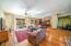 Expansive great room with bamboo flooring, dining room on right.
