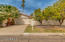Beautiful curb appeal with low maintenance landscaping and citrus tree.