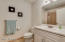 Second bathroom has attractive white cabinetry and newer shower/tub.