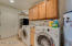 Inside laundry with built in cabinets for storage