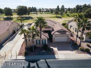 Located on a South facing golf course lot in the guard gated 55+ community of Arizona Traditions, this special 2199sf Papago has a spectacular golf course view!