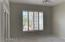 Nice size glass enclosed den/office with inset walls on back side.