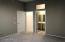 Guest bedroom door to hall, door to walk-in closet and door to private suite bathroom