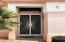 Double front security doors with sun burst design welcome your guests.