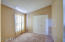 Double doors to living room--use as a den or bedroom