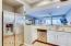 Recessed refrigerator, expanded kitchen counter space, slab granite counters