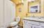 Roomy secondary bathroom, slab granite counters