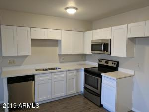 Upgraded Kitchen with White Shaker Cabinets, Quartz Counter, and SS Appliances