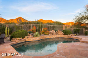 Sunset on mountains over pool
