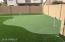 Back yard entertainment with artificial turf for low maintenance.