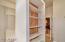 Walk in closet, with cedar shelving.