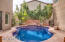 Courtyard pool with waterfall. Depth of pool in center 5 feet
