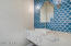 Powder room w/ accent tile wall