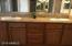 Dual sinks, Granite, Framed Mirror, with new light fixtures...plenty of storage.