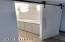 Sneak peek of guest bathroom through custom barn style door