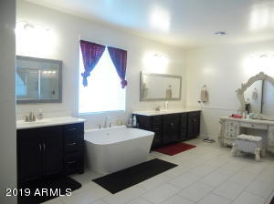 Spacious master bath with relaxing tub.