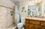 Designer marble and stone throughout. Extra high vanity with solid cabinetry.