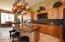 """42"""" Alder upper cabinets. Granite counter & backsplash, under cabinet lighting. Gas Cooktop"""