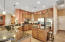 large kitchen with granite countertops, stainless steel appliances and double ovens