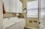 very nice laundry room with cabinets