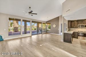 Large Vaulted Ceilings in Living Room and Dining Room. Open up into kitchen.