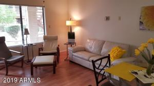 Leather appointments in spacious living/dining combination.